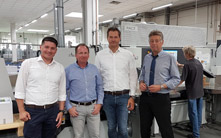 Marc König, postpress specialist of HD Germany, Marco Böke, managing director of druckpartner, Wilfried Munkelt, sales representative of HD Germany and Gerhard Florian, plant manager of druckpartner (fr. left to right)